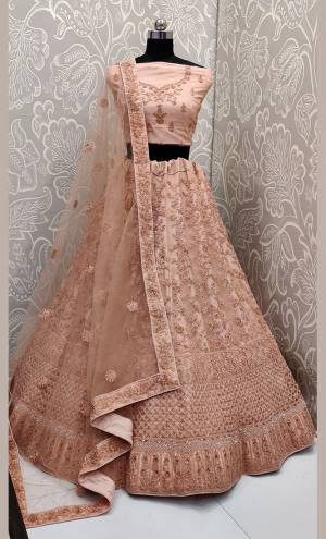 This Wedding Season, Look The Most Graceful Of All Wearing This Heavy Designer Elegant Lehenga Choli In Peach Color. Its Blouse, Lehenga And Dupatta are Fabricated on Net Beautified With Tone To Tone Coding And Resham Embroidery With Stone Work. Its Pretty Elegant Color And Tone-To-Tone Work Will Definitely Earn You Lots Of Compliments From Onlookers.
