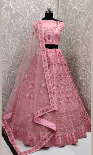 This Wedding Season, Look The Most Graceful Of All Wearing This Heavy Designer Elegant Lehenga Choli In Pink Color. Its Blouse, Lehenga And Dupatta are Fabricated on Net Beautified With Tone To Tone Coding And Resham Embroidery With Stone Work. Its Pretty Elegant Color And Tone-To-Tone Work Will Definitely Earn You Lots Of Compliments From Onlookers.