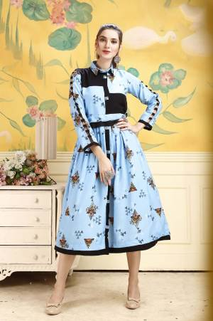 Grab This Pretty Readymade Tunic In Sky Blue Color For Your Semi-Casual Wear. This Pretty Kurti Is Fabricated On Rayon Beautified With Prints All Over. Buy This Pretty Piece Now.