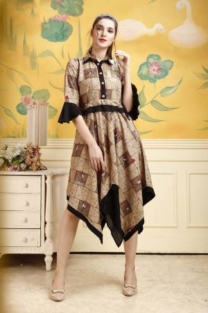 Grab This Pretty Readymade Tunic In Brown Color For Your Semi-Casual Wear. This Pretty Kurti Is Fabricated On Rayon Beautified With Prints All Over. Buy This Pretty Piece Now.