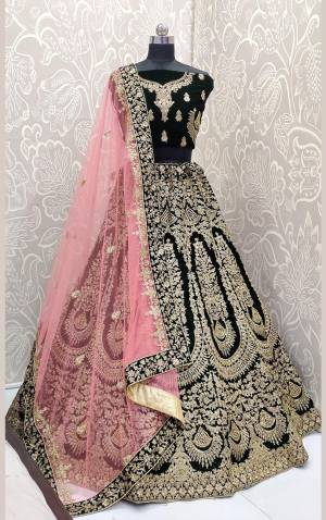 Here Is A Beautiful Designer Bridal Lehenga Choli In Dark Green?Color Paired With Baby Pink Colored Dupatta. This Beautiful Heavy Lehenga Choli Is Fabricated On Velvet Paired With Net Fabricated Dupatta. It Is Beautified With Heavy Detailed Embroidery. Get Ready For Your D-Day With This Designer Piece And Look The Most Graceful Of All.?