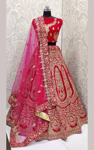 Here Is A Beautiful Designer Bridal Lehenga Choli In Rani Pink Color. This Beautiful Heavy Lehenga Choli Is Fabricated On Velvet Paired With Net Fabricated Dupatta. It Is Beautified With Heavy Detailed Embroidery. Get Ready For Your D-Day With This Designer Piece And Look The Most Graceful Of All