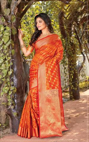 Celebrate This Festive Season Wearing This Designer Saree In Orange Color. This Saree Is Fabricated On Cotton Silk Paired With Jacquard Silk Fabricated Blouse Beautified With Weave.