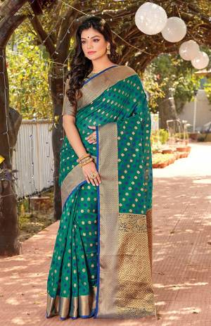 Celebrate This Festive Season Wearing This Designer Saree In Teal Green Color. This Saree Is Fabricated On Cotton Silk Paired With Jacquard Silk Fabricated Blouse Beautified With Weave.