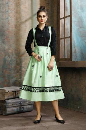 Grab This Pretty Two-Piece Readymade Dress Which Has A Black Colored Shirt Paired With A Dungaree Dress In Light Green Color. The Shirt Is Fabricated on Rayon Paired With Cotton Based Over Dress. It Is Light In Weight And Easy To Carry All Day Long.