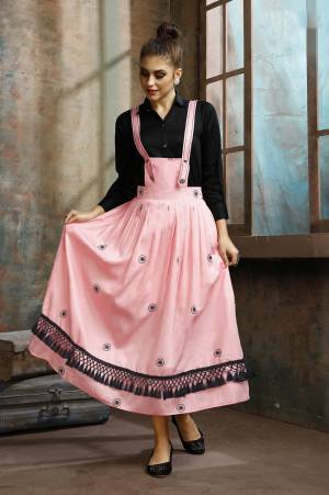 Grab This Pretty Two-Piece Readymade Dress Which Has A Black Colored Shirt Paired With A Dungaree Dress In Pink Color. The Shirt Is Fabricated on Rayon Paired With Cotton Based Over Dress. It Is Light In Weight And Easy To Carry All Day Long.
