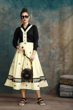 Grab This Pretty Two-Piece Readymade Dress Which Has A Black Colored Shirt Paired With A Dungaree Dress In Light Yellow Color. The Shirt Is Fabricated on Rayon Paired With Cotton Based Over Dress. It Is Light In Weight And Easy To Carry All Day Long.