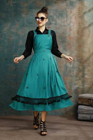 Grab This Pretty Two-Piece Readymade Dress Which Has A Black Colored Shirt Paired With A Dungaree Dress In Teal Blue Color. The Shirt Is Fabricated on Rayon Paired With Cotton Based Over Dress. It Is Light In Weight And Easy To Carry All Day Long.
