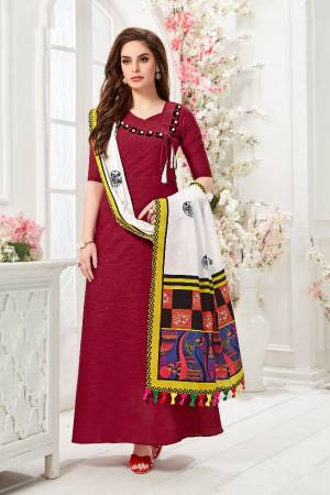 Here Is A Pretty Readymade Gown In Maroon Color Paired With White And Multi Colored Dupatta. This Pretty Gown Is Fabricated On Cotton Slub Paired With Chanderi Cotton Fabricated Dupatta Beautified With Digital Prints.