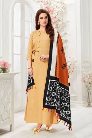 Here Is A Pretty Readymade Gown In Beige Color Paired With Rust Orange And Black Colored Dupatta. This Pretty Gown Is Fabricated On Cotton Slub Paired With Chanderi Cotton Fabricated Dupatta Beautified With Digital Prints.