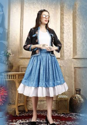 Here Is A Pretty Three Piece Western Set In White Colored Top Paired With Blue Colored Skirt And Black Colored Printed Jacket. Its Top Is Fabricated on Cotton Lycra Paired With Rayon Fabricated Skirt and Jacket.