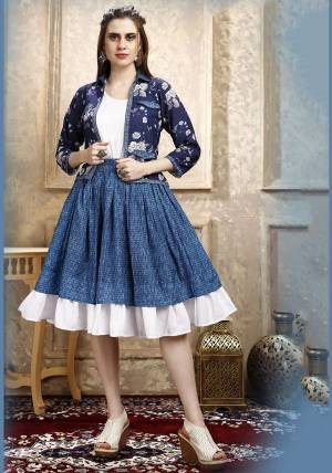 Here Is A Pretty Three Piece Western Set In White Colored Top Paired With Blue Colored Skirt And Navy Blue Colored Printed Jacket. Its Top Is Fabricated on Cotton Lycra Paired With Rayon Fabricated Skirt and Jacket.