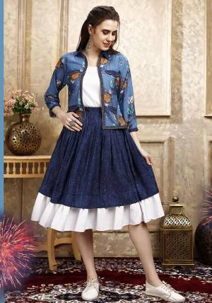 Here Is A Pretty Three Piece Western Set In White Colored Top Paired With Blue Colored Skirt And Blue Colored Printed Jacket. Its Top Is Fabricated on Cotton Lycra Paired With Rayon Fabricated Skirt and Jacket.