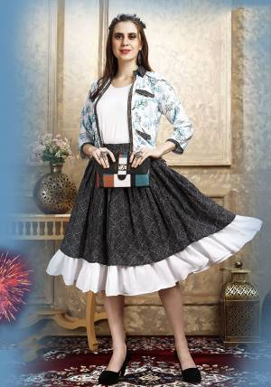 Here Is A Pretty Three Piece Western Set In White Colored Top Paired With Blue Colored Skirt And White Colored Printed Jacket. Its Top Is Fabricated on Cotton Lycra Paired With Rayon Fabricated Skirt and Jacket.