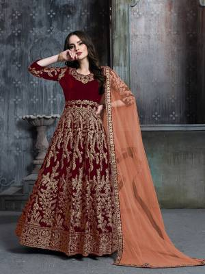 Get Ready For The Upcoming Wedding And Festive Season Wearing This Heavy Designer Floor Length Suit  In Red Color Paired With Light Orange Colored Dupatta. Its Heavy Embroidered Top Is Fabricated on Velvet Paired With Santoon Bottom And Net Fabricated Dupatta.