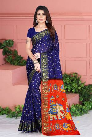 Celebrate This Festive Season Wearing This Pretty Saree In Navy Blue Color. This Saree And Blouse Are Silk Based Beautified With Prints. Also It Is Light In Weight Which Is Perfect For Festive Wear. Buy Now.