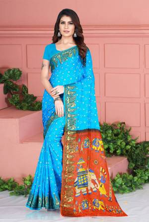 Celebrate This Festive Season Wearing This Pretty Saree In Blue Color. This Saree And Blouse Are Silk Based Beautified With Prints. Also It Is Light In Weight Which Is Perfect For Festive Wear. Buy Now.