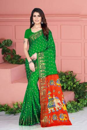 Celebrate This Festive Season Wearing This Pretty Saree In Green Color. This Saree And Blouse Are Silk Based Beautified With Prints. Also It Is Light In Weight Which Is Perfect For Festive Wear. Buy Now.