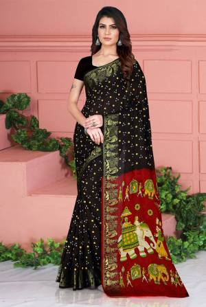 Celebrate This Festive Season Wearing This Pretty Saree In  Black Color. This Saree And Blouse Are Silk Based Beautified With Prints. Also It Is Light In Weight Which Is Perfect For Festive Wear. Buy Now.