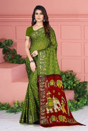 Celebrate This Festive Season Wearing This Pretty Saree In Olive Green Color. This Saree And Blouse Are Silk Based Beautified With Prints. Also It Is Light In Weight Which Is Perfect For Festive Wear. Buy Now.