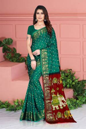Celebrate This Festive Season Wearing This Pretty Saree In Teal Green Color. This Saree And Blouse Are Silk Based Beautified With Prints. Also It Is Light In Weight Which Is Perfect For Festive Wear. Buy Now.