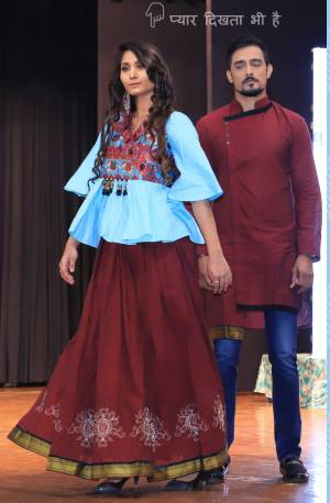 Grab This Special Combo Of Men And Women In Maroon And Sky Blue Color Which Is Fully Stitched And Available In All Regular Sizes. In This Combo You will Be Getting A Lehenga & Choli With Matching Men's Wear Kurta. All Three Pieces Are Fabricated On Khadi Cotton Which Is Light Weight, Durable And Easy To Carry Throughout The Gala. Buy Now.