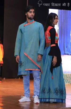 Grab This Special Combo Of Men And Women In Blue And Orange Color Which Is Fully Stitched And Available In All Regular Sizes. In This Combo You will Be Getting A Lehenga & Choli With Matching Men's Wear Kurta. All Three Pieces Are Fabricated On Khadi Cotton Which Is Light Weight, Durable And Easy To Carry Throughout The Gala. Buy Now.