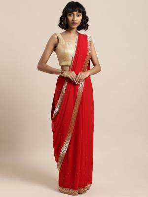 Add This Pretty Elegant Looking Saree To Your Wardrobe In Red Color Paired With Red Colored Blouse. This Saree Is Fabricated On Georgette Paired With Art Silk Fabricated Blouse. It Is Beautified With Jacquard Lace Border And Stone Work. Buy Now.