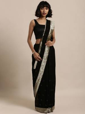 Add This Pretty Elegant Looking Saree To Your Wardrobe In Black Color Paired With Black Colored Blouse. This Saree Is Fabricated On Georgette Paired With Art Silk Fabricated Blouse. It Is Beautified With Jacquard Lace Border And Stone Work. Buy Now.