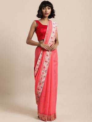 Celebrate This Festive Season In This Pretty Saree In Pink Color Paired With Red Colored Blouse, This Pretty Saree Is Georgette Based Paired With Art Silk Fabricated Blouse. It Is Light In Weight And Easy To Carry All Day Long.