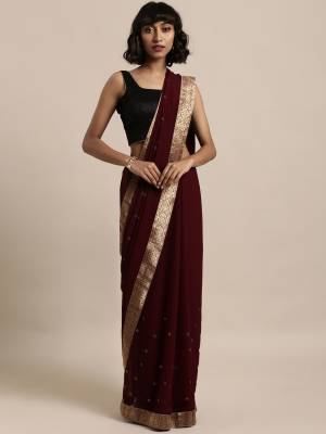 Add This Pretty Elegant Looking Saree To Your Wardrobe In Maroon Color Paired With Maroon Colored Blouse. This Saree Is Fabricated On Georgette Paired With Art Silk Fabricated Blouse. It Is Beautified With Jacquard Lace Border And Stone Work. Buy Now.