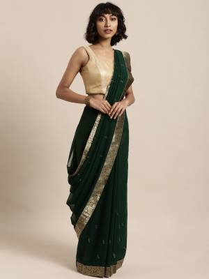Add This Pretty Elegant Looking Saree To Your Wardrobe In Pine Green Color Paired With Pine Green Colored Blouse. This Saree Is Fabricated On Georgette Paired With Art Silk Fabricated Blouse. It Is Beautified With Jacquard Lace Border And Stone Work. Buy Now.