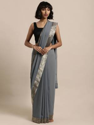 Celebrate This Festive Season In This Pretty Saree In Grey Color Paired With Grey Colored Blouse, This Pretty Saree Is Georgette Based Paired With Art Silk Fabricated Blouse. It Is Light In Weight And Easy To Carry All Day Long.