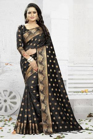 Celebrate This Festive Season Wearing This Designer Silk Based Saree In Black Color. This Saree And Blouse Are Fabricated On Banarasi Art Silk Beautified With Weave. It Is Light Weight, Durable And Easy To Carry All Day Long. Buy Now.