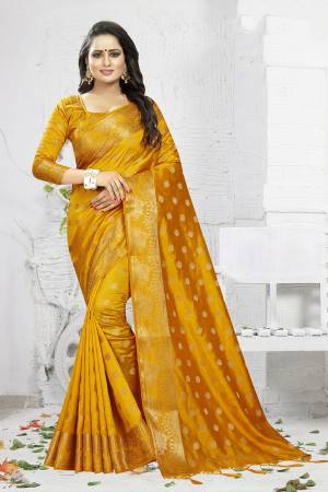 Celebrate This Festive Season Wearing This Designer Silk Based Saree In Musturd Yellow Color. This Saree And Blouse Are Fabricated On Banarasi Art Silk Beautified With Weave. It Is Light Weight, Durable And Easy To Carry All Day Long. Buy Now.