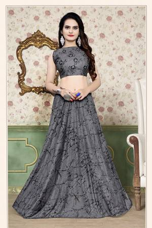Grab This Beautiful Pair Of Lehenga Choli In Grey Color Fabricated On Lycra. It Has Fully Stitched Lehenga And Unstitched Blouse. Also It Is Beautified With Foil Print Giving It An Attractive Look. Buy Now.