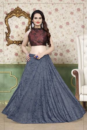 Grab This Beautiful Pair Of Lehenga Choli In Brown And Grey Color Fabricated On Lycra. It Has Fully Stitched Lehenga And Unstitched Blouse. Also It Is Beautified With Foil Print Giving It An Attractive Look. Buy Now.
