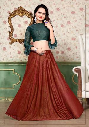 Grab This Beautiful Pair Of Lehenga Choli In Teal Green And Red Color Fabricated On Lycra. It Has Fully Stitched Lehenga And Unstitched Blouse. Also It Is Beautified With Foil Print Giving It An Attractive Look. Buy Now.