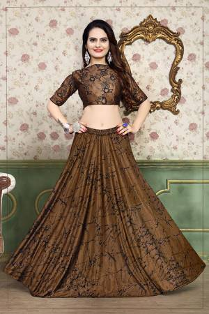 Grab This Beautiful Pair Of Lehenga Choli In Brown Color Fabricated On Lycra. It Has Fully Stitched Lehenga And Unstitched Blouse. Also It Is Beautified With Foil Print Giving It An Attractive Look. Buy Now.