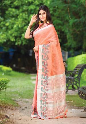 Flaunt Your Rich And Elegant Taste Wearing This Pretty Saree In Peach Color Paired With Peach Colored Blouse. This Saree And Blouse Are Fabricated On Linen Beautified With Floral Weave. It Is Light In Weight And Gives A Rich Look To Your Personality.