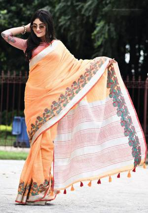 Flaunt Your Rich And Elegant Taste Wearing This Pretty Saree In Orange Color Paired With Red Colored Blouse. This Saree And Blouse Are Fabricated On Linen Beautified With Floral Weave. It Is Light In Weight And Gives A Rich Look To Your Personality.