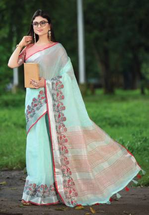 Celebrate This Festive Season with beauty and Comfort In This Lovely Aqua Blue Colored saree Paired With Peach Colored Blouse. This Saree And Blouse Are Fabricated On Linen Which Gives A Rich And Elegant Look. Buy This Pretty Saree Now.