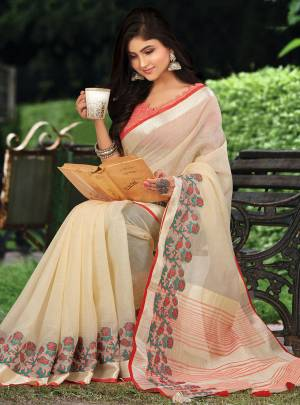 Celebrate This Festive Season with beauty and Comfort In This Lovely Cream Colored saree Paired With Red Colored Blouse. This Saree And Blouse Are Fabricated On Linen Which Gives A Rich And Elegant Look. Buy This Pretty Saree Now.
