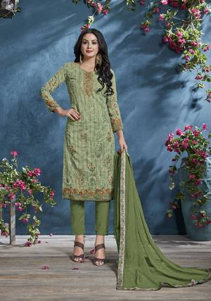 Add This Pretty Designer Straight Suit To Your Wardrobe In Green Color. This Petty Semi-Stitched Suit Is Cotton Based Paired With Santoon Bottom And Chiffon Dupatta. Its Top Is Beautified With Prints And Tone To Tone Resham Embroidery. Buy Now.