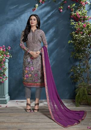 Here Is A Beautiful Shade To Add Into Your Wardrobe With This Designer Straight Suit In Mauve Color Paired With Purple Colored Dupatta. Its Tone To Tone Embroidered Top Is Cotton Based Paired With Santoon Bottom and Chiffon Fabricated Dupatta.
