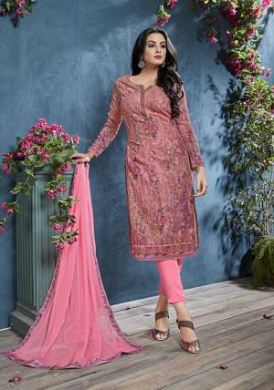 Look Pretty In Wearing This Lovely Semi-Stitched Suit In Pink Color. Its Top IS Fabricated On Cotton Beautified With Prints And Tone To Tone Resham Work Paired With Santoon Bottom And Chiffon fabricated Dupatta. Buy Now.