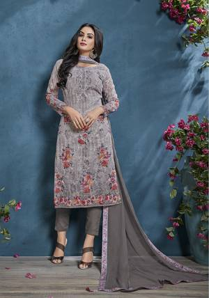 Here Is A Beautiful Shade To Add Into Your Wardrobe With This Designer Straight Suit In Grey Color. Its Tone To Tone Embroidered Top Is Cotton Based Paired With Santoon Bottom and Chiffon Fabricated Dupatta.