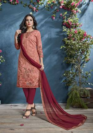 Look Pretty In Wearing This Lovely Semi-Stitched Suit In Dark Peach Color Paired With Maroon Colored Bottom And Dupatta. Its Top IS Fabricated On Cotton Beautified With Prints And Tone To Tone Resham Work Paired With Santoon Bottom And Chiffon fabricated Dupatta. Buy Now.