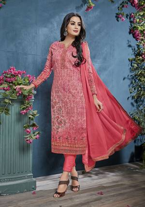 Add This Pretty Designer Straight Suit To Your Wardrobe In Old Rose Pink Color. This Petty Semi-Stitched Suit Is Cotton Based Paired With Santoon Bottom And Chiffon Dupatta. Its Top Is Beautified With Prints And Tone To Tone Resham Embroidery. Buy Now.