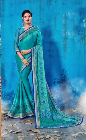 For Your Semi-Casual Wear, Grab This Pretty Saree In Blue Color Paired With Blue Colored Blouse. This Saree And Blouse Are Fabricated On Soft Silk Beautified With Prints All Over. This Saree Is Light Weight, Soft Towards Skin And Easy To Carry All Day Long.